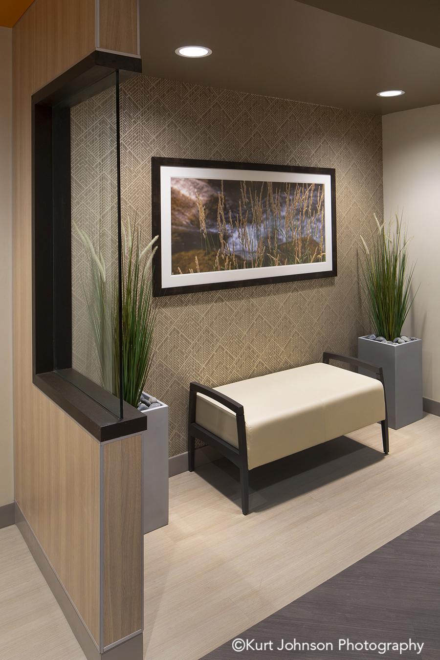 black framed art white matte botanical landscape install seating waiting lobby frame healthcare installation
