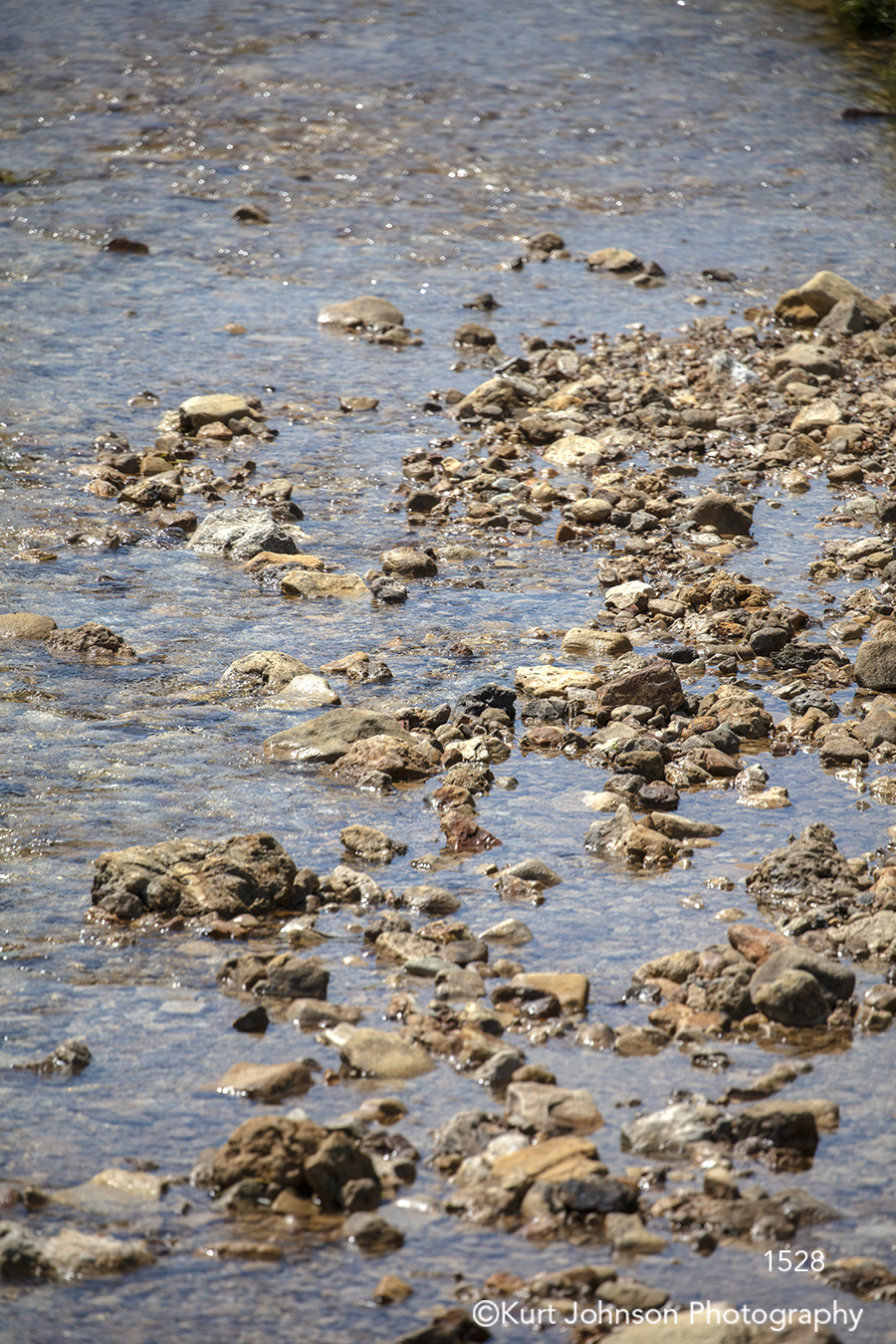 calm still water stream river rocks brown stone waterscape