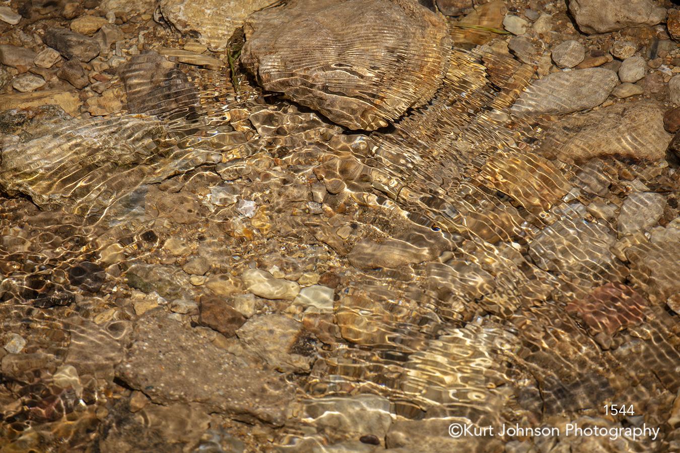 water rocks stone waterscape brown sand beach