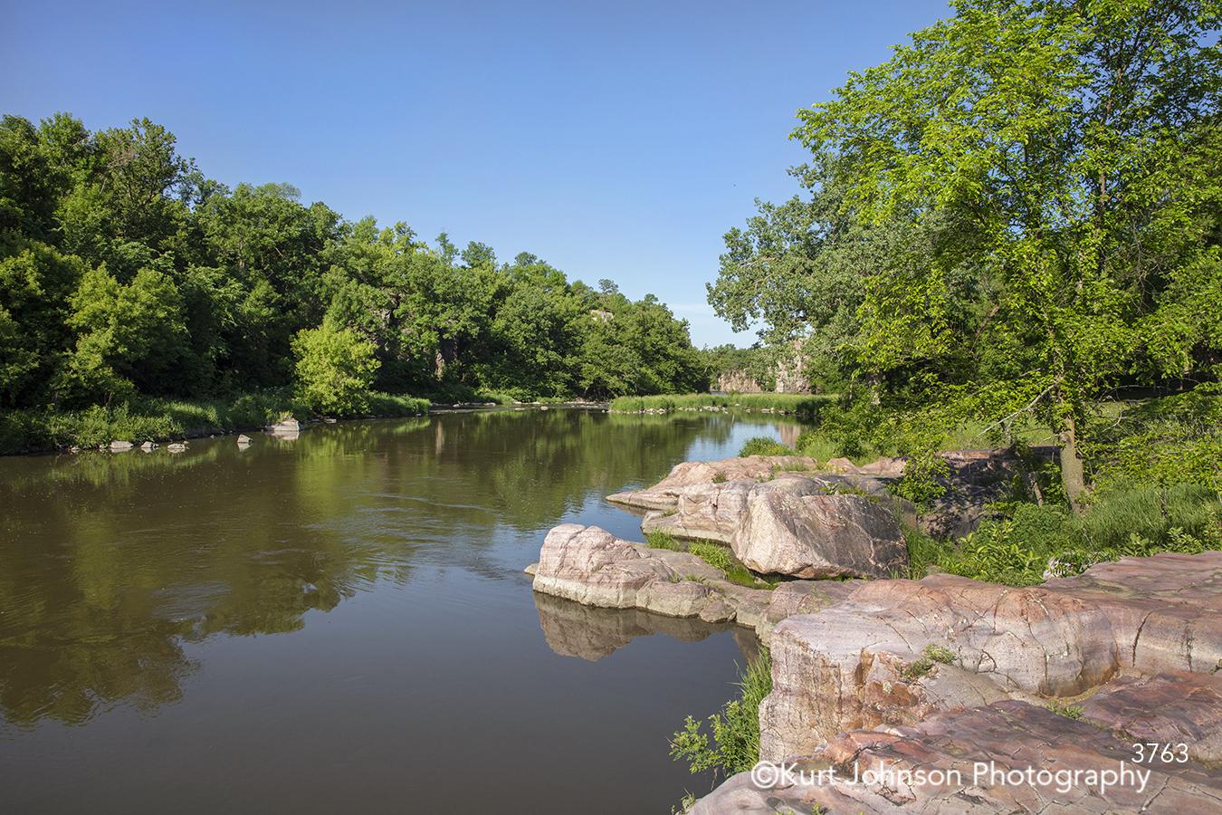 blue sky water reflection river stream rock stone shore edge green trees waterscape landscape