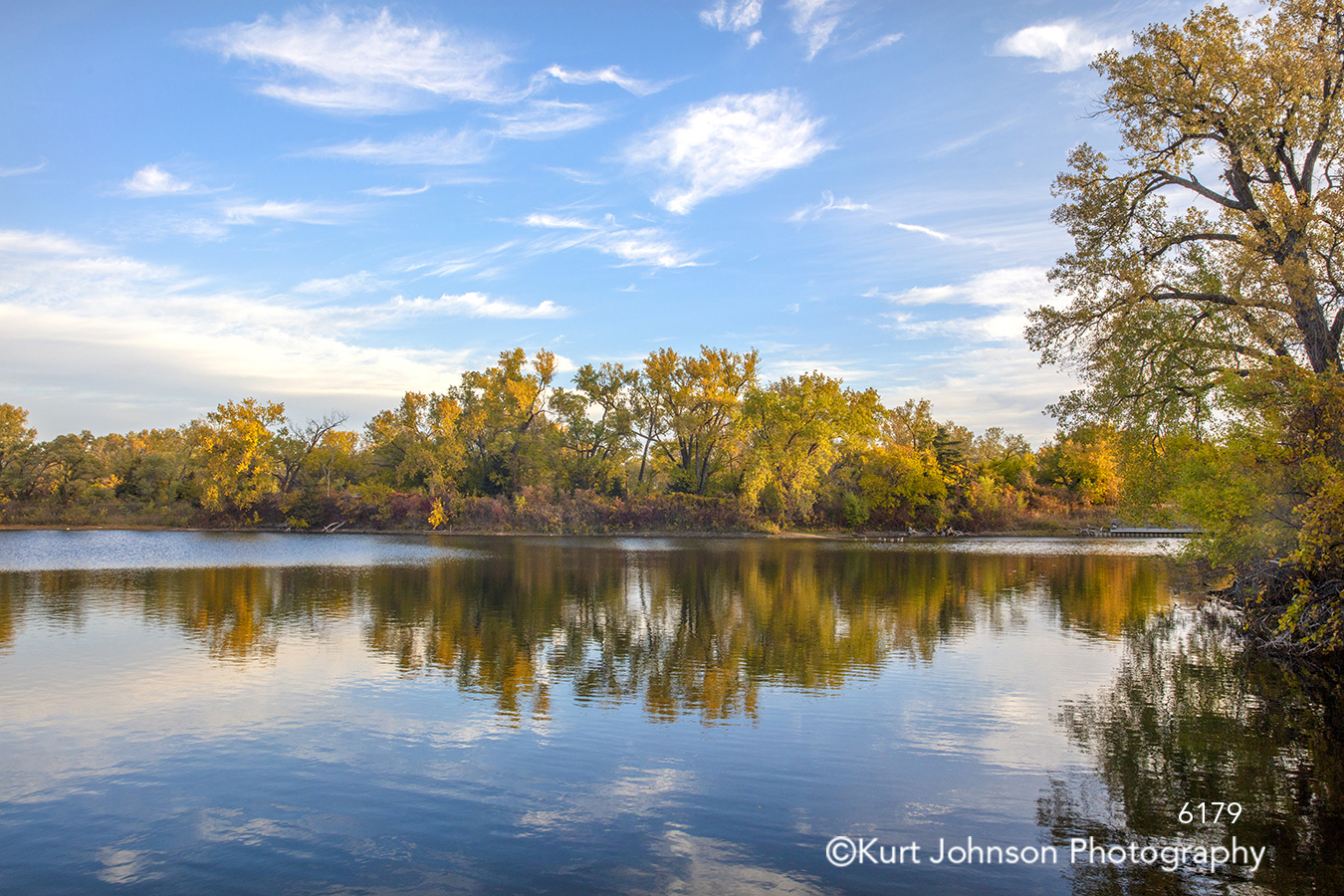 green yellow trees blue sky clouds water reflection waterscape landscape