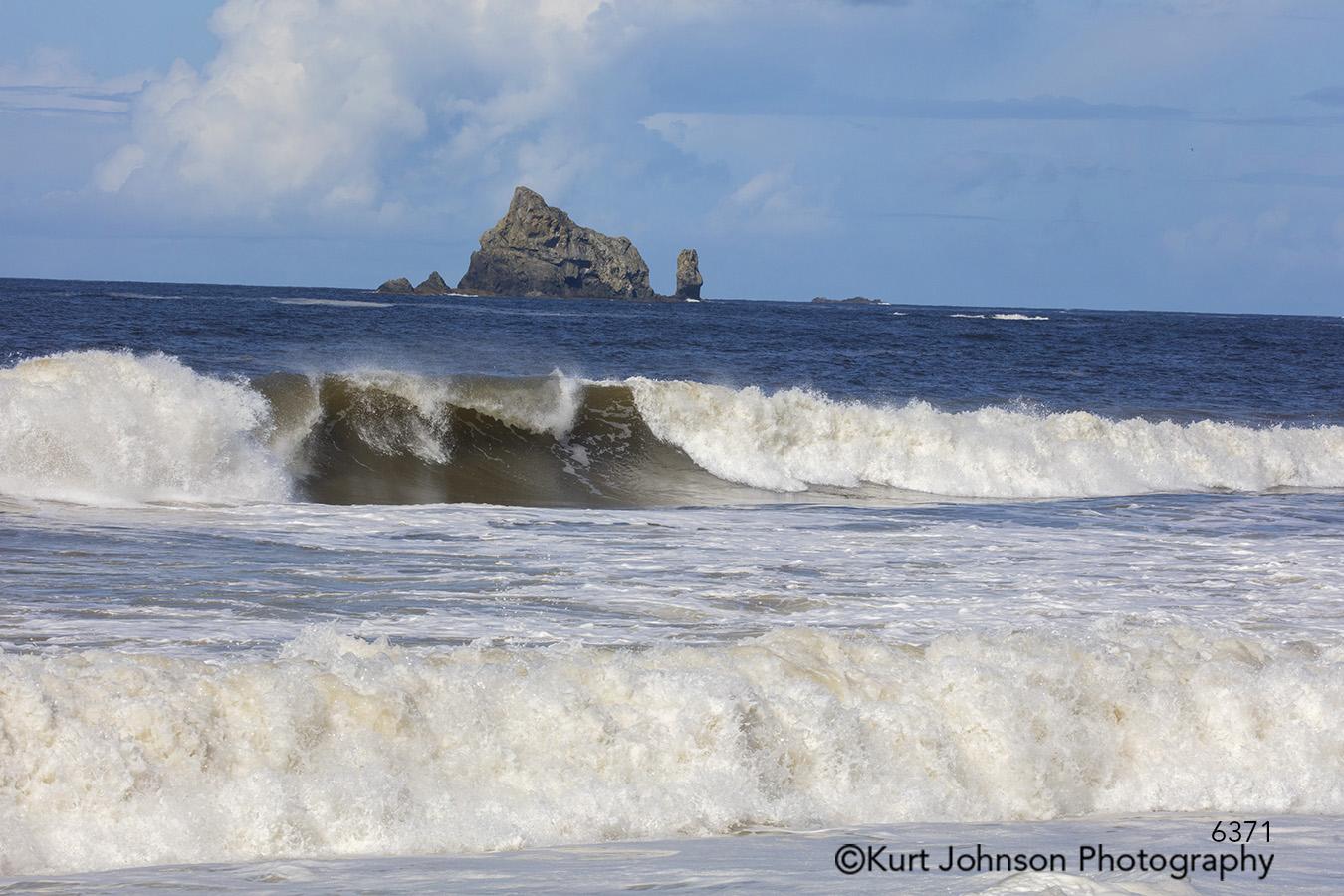 water shore waves beach ocean rocks waterscape blue sky clouds