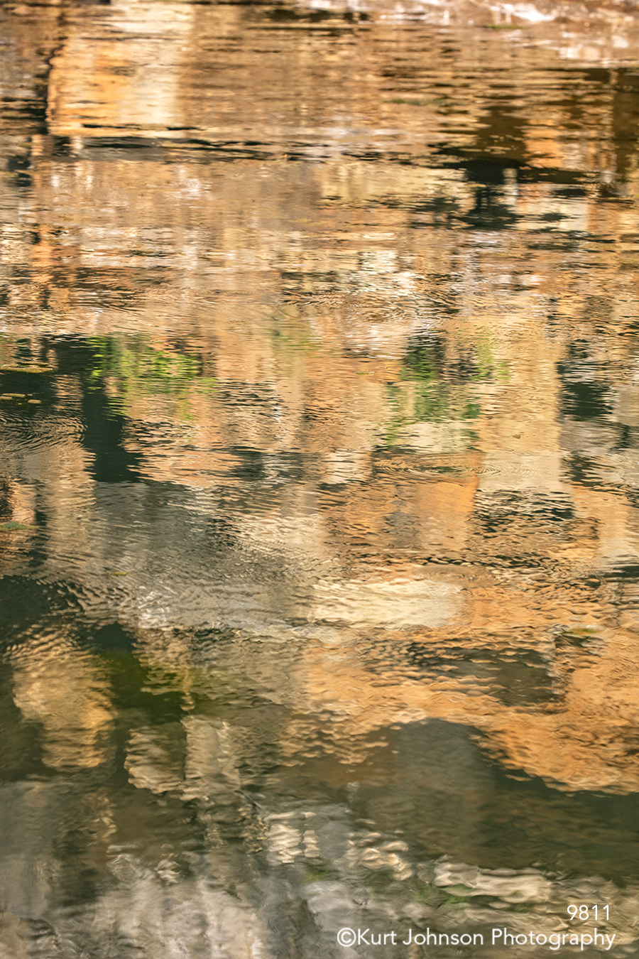 water waterscape reflection cliff cliffs brown rocks