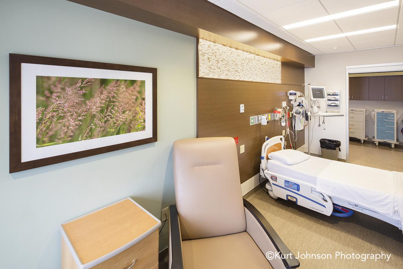 Brooking SD South Dakota install framed wall art frame installation brown yellow grass grasses patient room chair