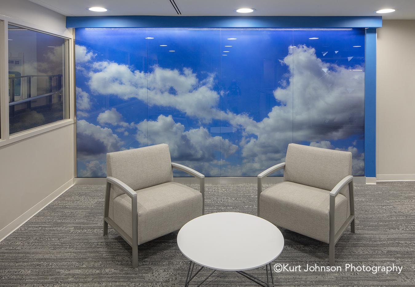 blue sky clouds landscape install glass lobby waiting installation Allina Health United Healthcare John Nasseff Medical Center atrium InVision Glass Design